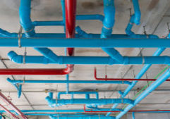 Hanging piping systems buildings for drainage and services construction of high rise residential modern building in the city
